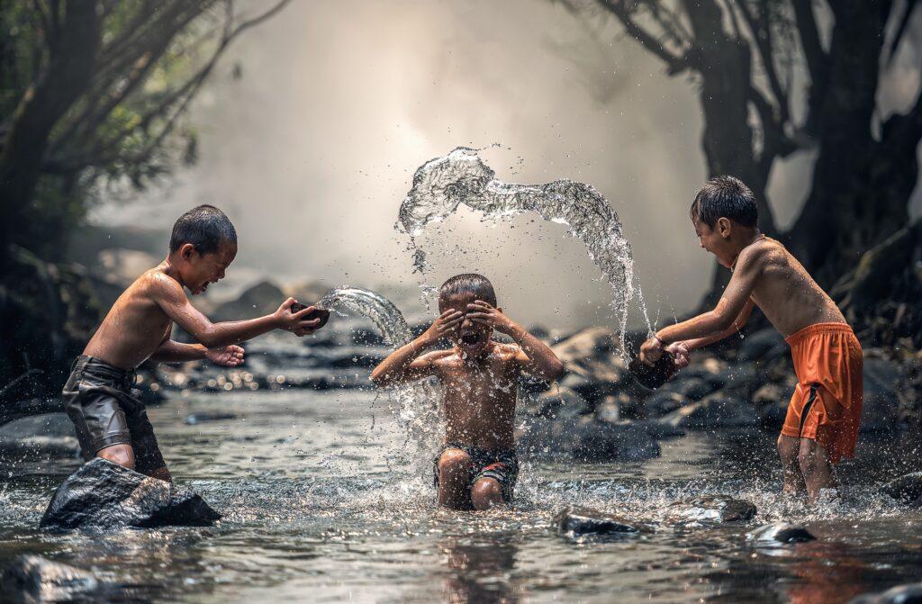 Children Splashing in Water